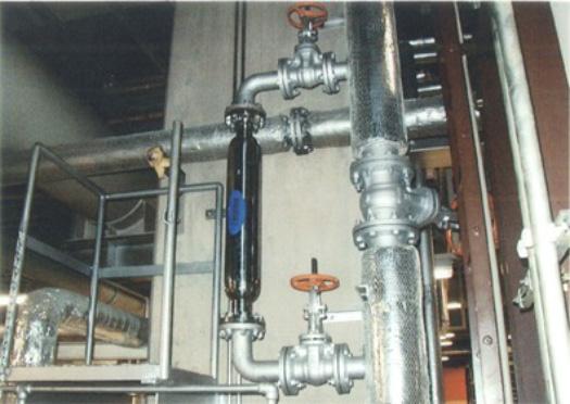炉筒煙管式ボイラーに高密度磁束活性水装置ビッグポールを設置